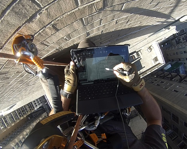 Engineer performing façade inspection using industrial rope access   façade inspection article   O'Donnell & Naccarato